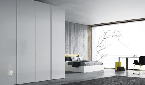 Wardrobe with four hinged doors in a modern bedroom