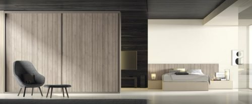 Wardrobe with two sliding doors in a modern adult bedroom