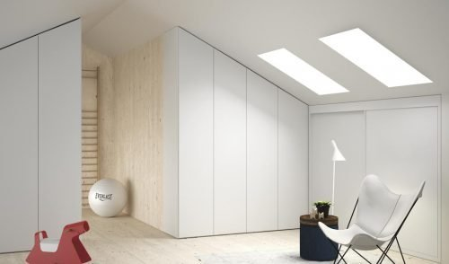 Loft with three made-to-measure wardrobes in colour Blanco