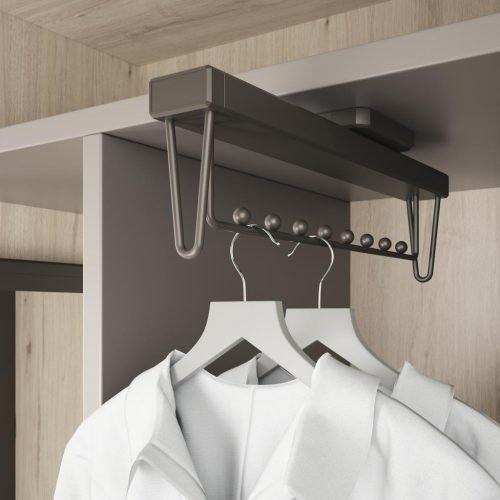 Detail of the extractable hangers for the interior of the walk-in wardrobe
