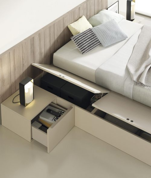 Detail of the rising drawers beside the bed