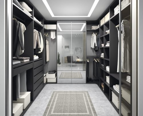Walk-in wardrobe with mirrors on the doors of the wardrobe