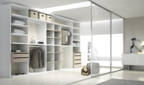 Open walk-in wardrobe in soft colours to increase the light in the room
